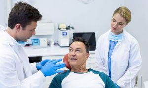 Dentist speaking to patient about oral health - Oral Cancer San Leandro, CA