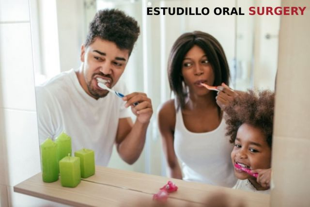 Mom and Dad brushing teeth with kids for a healthy smile - Estudillo, CA